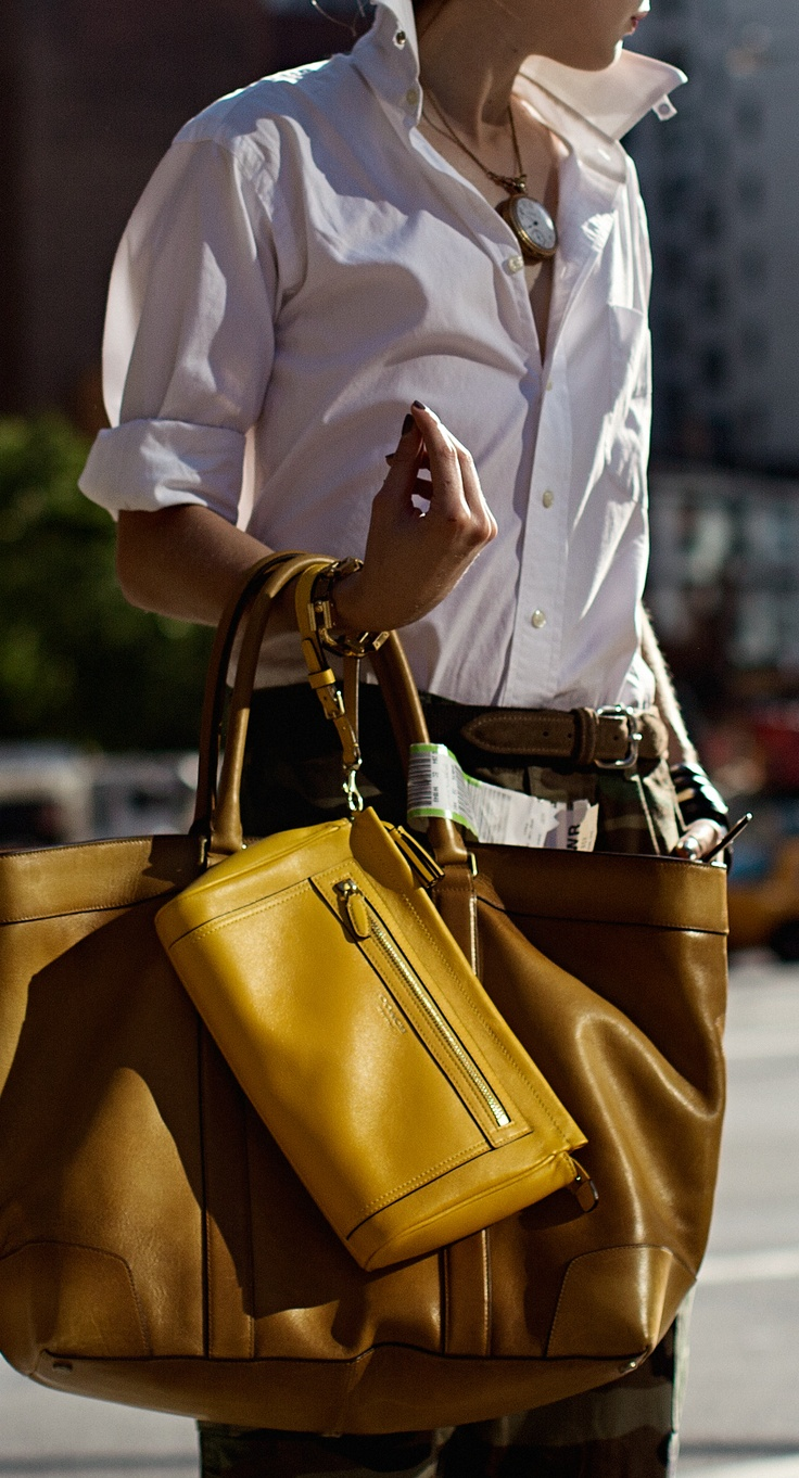 Mix and match: the Legacy Large Clutch and Men's Bleecker Legacy Leather Weekend Tote compliment each other perfectly.
