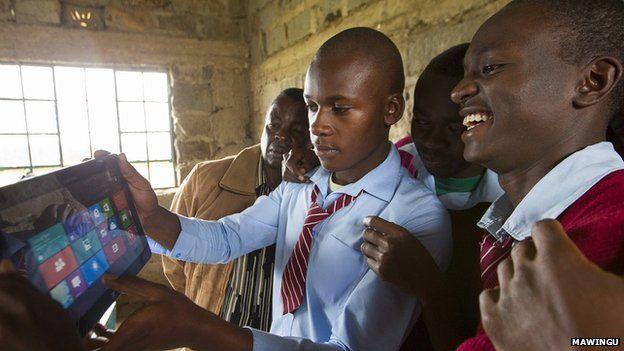 Schoolchildren with tablet computer