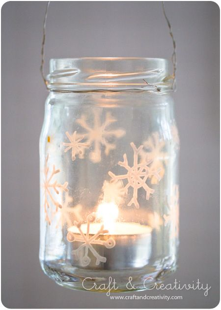 Draw snowflakes with a white Hobby Marker. To make a lantern, twist wire around the top and make a loop for hanging. Put votive candle or battery operated candle in jar.