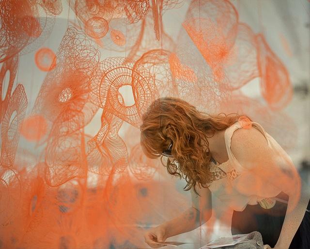 Toronto based textile artist Amanda McCavour engulfed in her installation piece