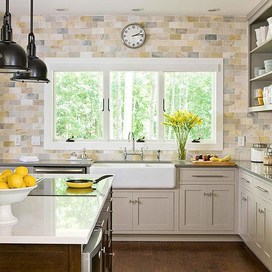 If you prefer to take a soft hand with color, look for backsplash tiles that are mostly netural, but include just a hint of color. Here, creamy beiges comprise the majority of the tile's coloring, but occasional hints of golden yellow and slate gray give the backsplash dimension./