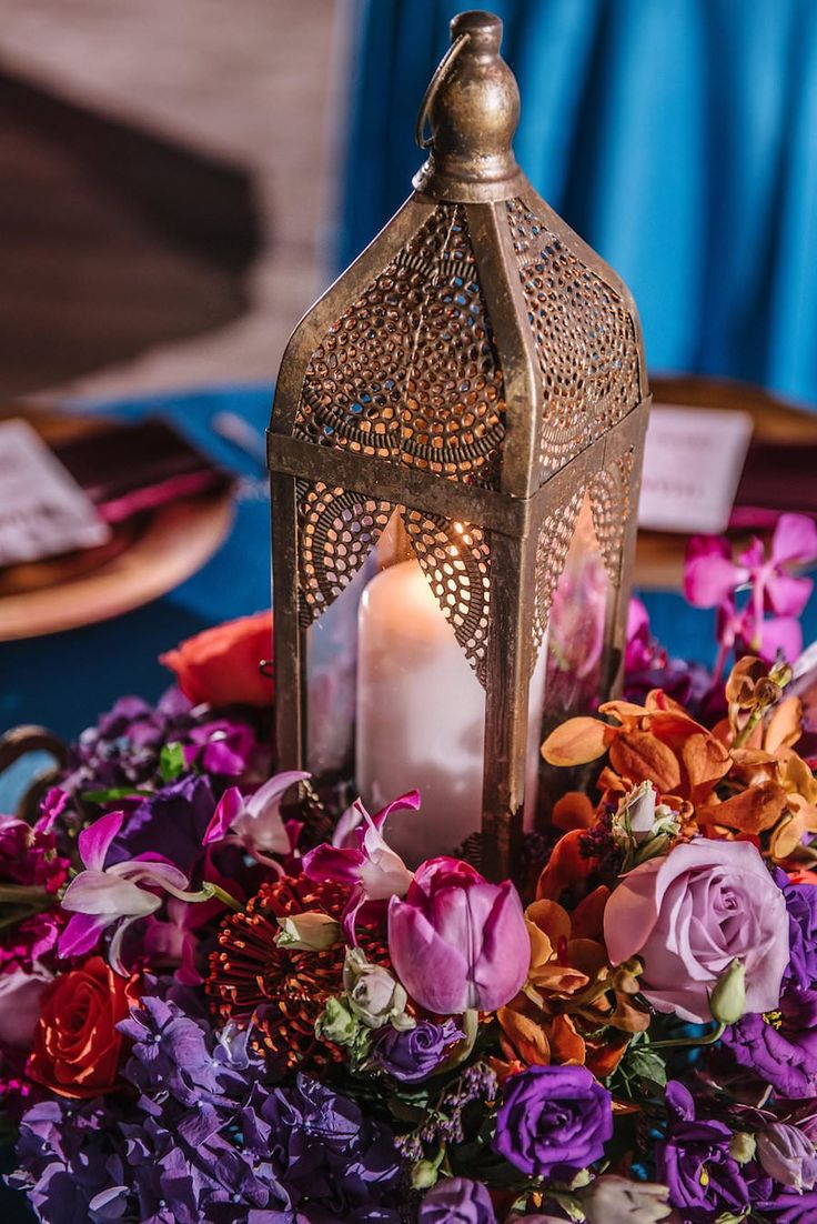 Wedding Reception Décor with Gold Moroccan Lanterns with Purple and Orange Floral Centerpieces on Teal Linens | Exquisite Events St. Pete Wedding Planner | Iza's Flowers Wedding Florist