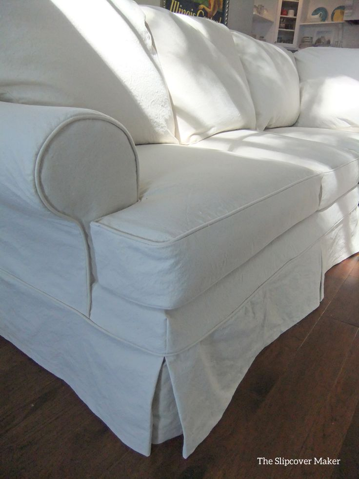 Slipcover in #12 natural duck cloth (canvas). Tough, protective and super versatile.