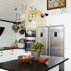 Brass hanging lamp with decorative butterflies in kitchen Layer by Wis Design