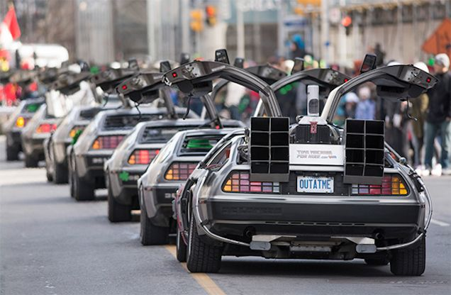 A prediction about the future that I'm pretty confident in making: this picture will be the best thing to come out of St Patrick's Day 2015. The photo, showing a line up of DeLoreans and a BTTF DeLorean caboose, was taken by BruceK and shows the DeLorean portion of the 2015 St. Patrick's Day Parade in Toronto.