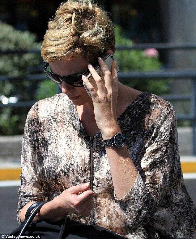 Roman holiday: Charlize was busy from the second she landed in Italy in her stylish outfit