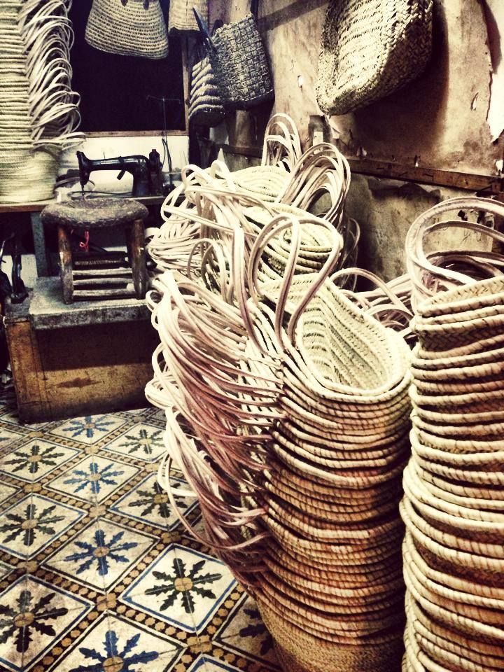 Our artisans are putting the leather trim & handles on our selection of baskets today in Marrakech.   This is how they all start before being adorned with beautiful accents so cool!  https://www.facebook.com/OneEarthwithm
