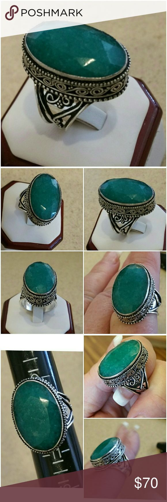 Genuine 39ct Natural Emerald Ring size 10 Wow!  Statement Solitaire!   Knows how to make an impact! Light colored 39ct Natural Emerald set in 925 stamped Solid Sterling Silver. Please see all pictures for details. Brand New. Never Worn. Wholesale Prices. Retail Value. 499.00 Jewelry Rings