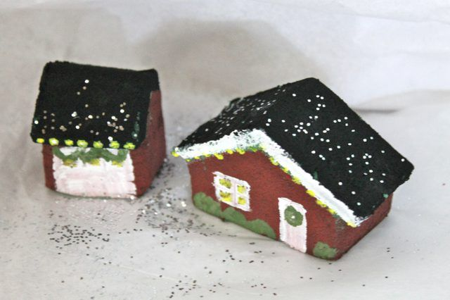 A charming Christmas village display is a whimsical way to decorate your home for the holidays. Small novelty buildings can be purchased from Christmas stores to set up your own village at home, but these can sometimes be costly. Instead, consider making one yourself by hand. You can use Styrofoam craft cubes from a craft store to make the little...