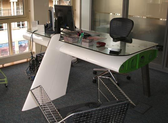 Very stylish recycled airplane wing desk and recycled shopping cart chair
