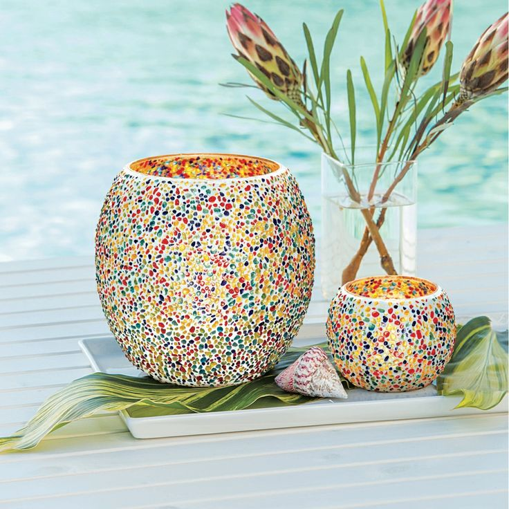 Fun for day and night! Konfetti Hurricane and Konfetti Votive Holder. Available March 27.