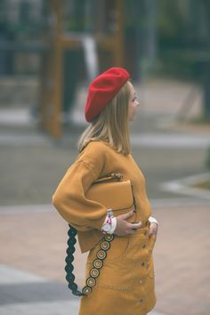 Fall 2017 monochrome outfit  white ankle boots guitar strap bag red beret yellow button skirt