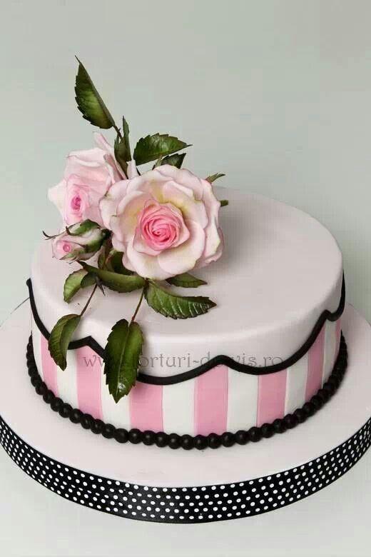 Pink, black and white cake