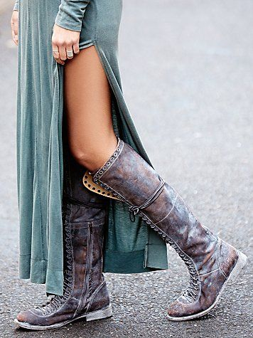 Caspian Tall Lace Up Boot | Tall leather utility boot with lace-up detailing all the way up the front. Rounded toe. Inside side zip for an easy fit. *By Faryl Robin + Free People **Special Note: Due to the unique stone washed finish of these boots, expect the surface to continue to change with time and wear.