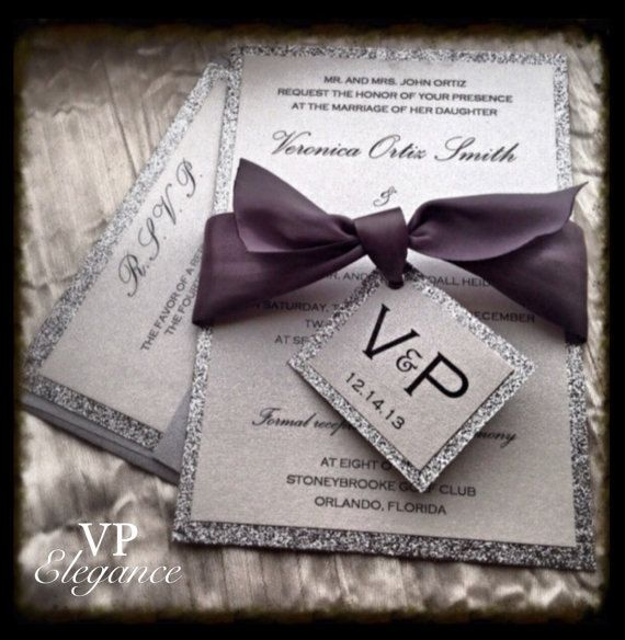 Silver Glitter Wedding Invitations suite with ribbon belt and initials or monogram tag. How to order: The price listed is for one sample. This listing includes pictures of purple and pewter ribbon. Other colors and quantities available. Please indicate preferred ribbon color. If no request is received the sample will ship with pewter ribbon. How to order: The price listed is for one sample. Other colors and quantities available. To receive a quote for customization and larger orders please…
