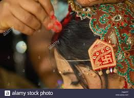 The tradition of wearing sindoor (vermillion) by married women has been explained in Indian mythology. According to religious scriptures, red is the color of power and sindoor represents the female energy of Sati and Parvati. Sati is considered an ideal Hindu wife because she gave her life for her husband's honor.