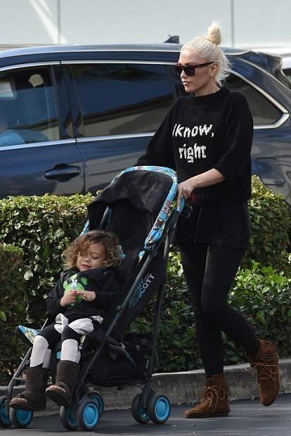 Gwen Stefani wearing Jeremy Scott Cybex Onyx Stroller and Smythe I Know Sweater