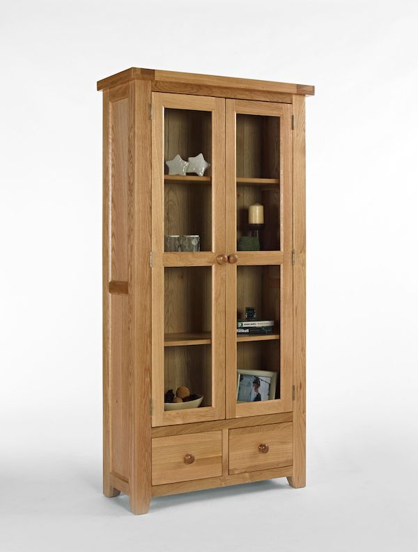 A great display cabinet with glass doors made from high quality strong and sturdy solid oak.