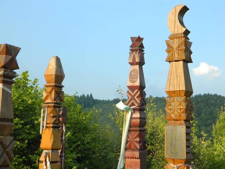 1848 Memorial -- carved Szekely grave markers with stars and moon on top