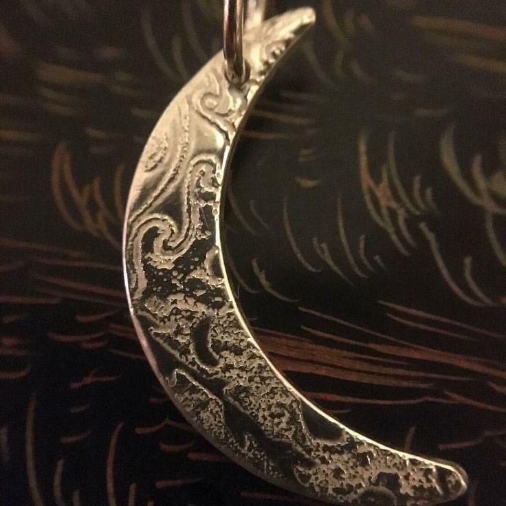 Fine sterling silver crescent moon.