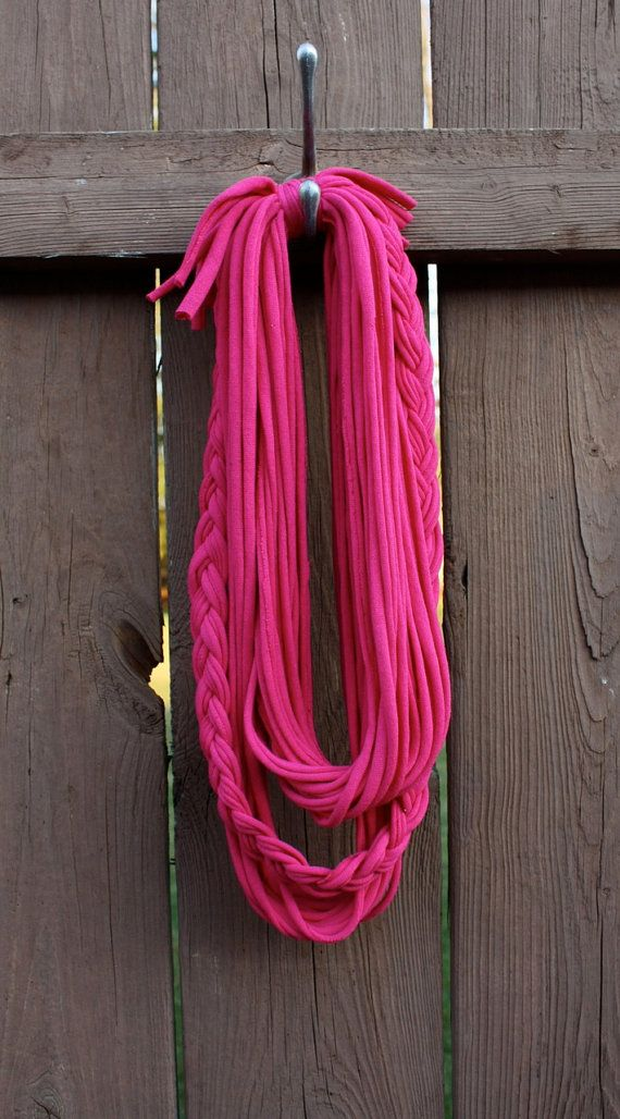 Who doesnt like re purposed items?    This bright pink, braided, doubled up, tshirt scarf is great for just about any occasion! It can act as a necklace or scarf, and are great gifts for young and old!    This scarf was handmade from a brand new cotton tshirt, re purposed into this very stylish accessory. Its multi strand and braided touch will have everyone around you talking.    *This item was made in a pet and smoke free environment.    Care instructions: Hand wash cold, hang to dry.