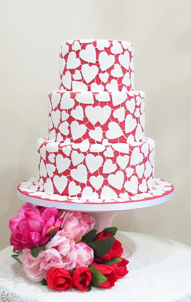 Heart shaped cake covered in white hearts