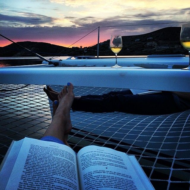 Good book, glass of wine and view (of Helene's feet)