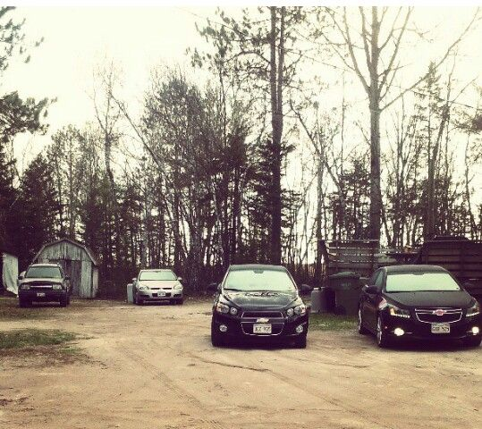 Family photo! 2004 Chevy tracker,  2006 Impala ss, 2013 Sonic and my 2011 cruze!