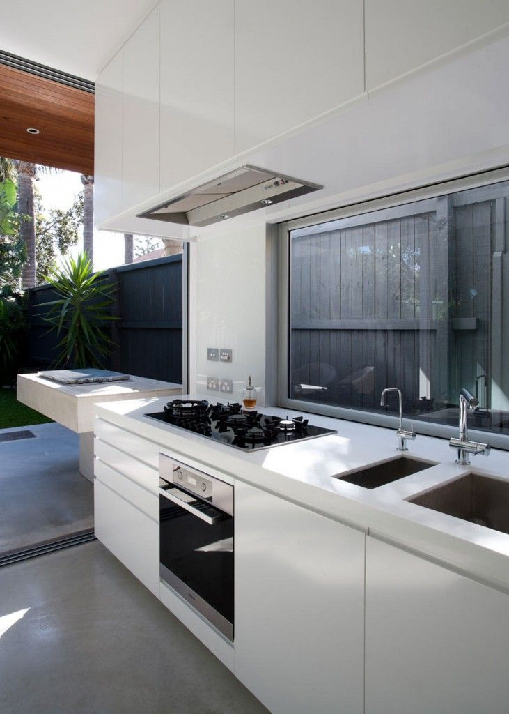 #Kitchen with outdoor grill extension - North Bondi House by MCK Architects in New South Wales, Australia