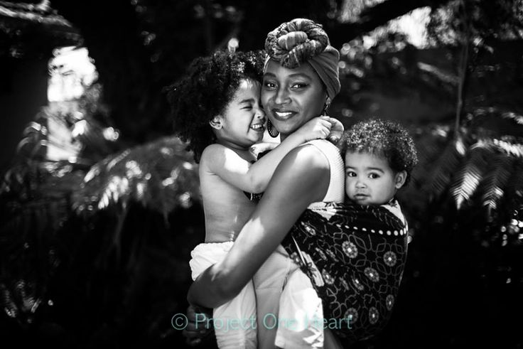 "Mumbi  WOC mothers, Women of Color.  Project One Heart ""Increasing the visibilityof Mothers of Color"" Collaboration between Christelle Barrere-Collet (Australian Babywearing Collective) and Belle Verdiglione (Photographer).  Photo by Belle Verdiglione."