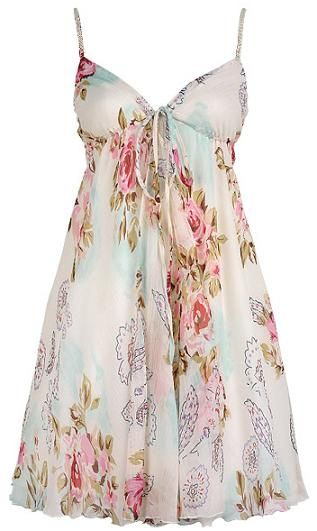 Beautiful pink and white floral dress made of poly/cotton.