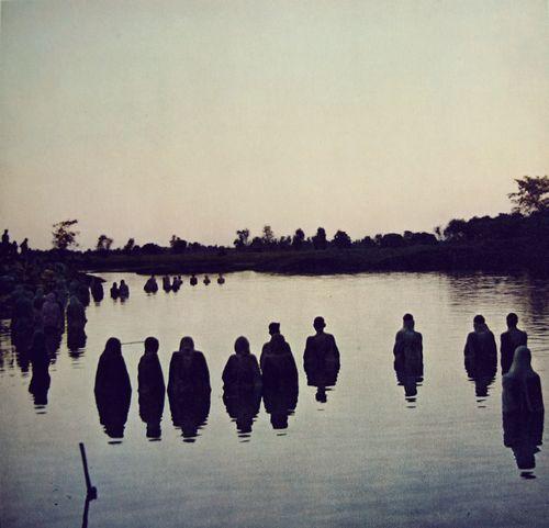 Pilgrims bathing in the Ganges River