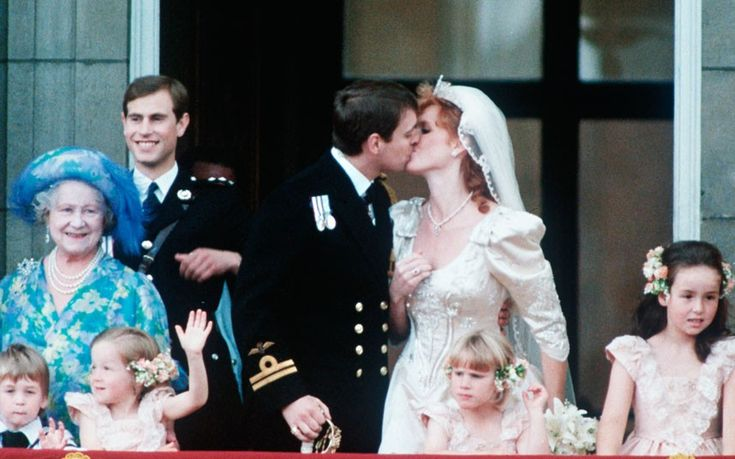July 23, 1986: Prince Andrew kisses Sarah Ferguson on the balcony at Buckingham Palace after their wedding ceremony