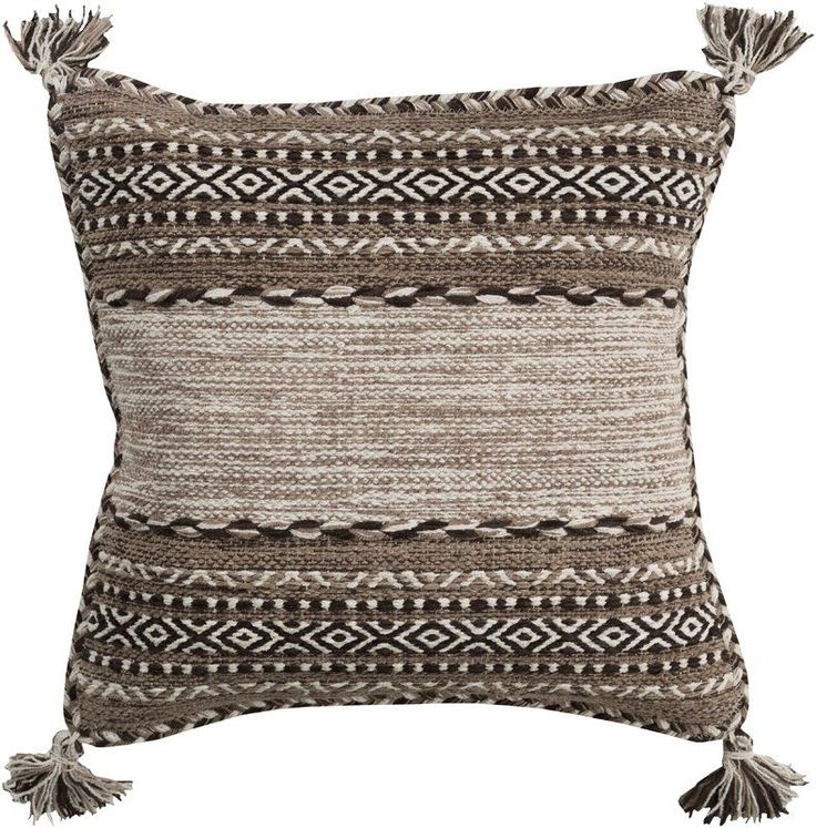 Switching up your style in the master suite? Try setting the tone with this eye-popping pillow! With a southwestern-inspired geometric motif in tonal hues and tassel accents at each corner, it's sure to stand out against a neutral-hued quilt. Bring in even more beauty by adorning a nightstand on either side with a flickering candle lantern for a warm and restful glow, then play into the lodge-worthy look with a faux fur rug on the floor below. Stuffed with a polyester fill for a classic s...