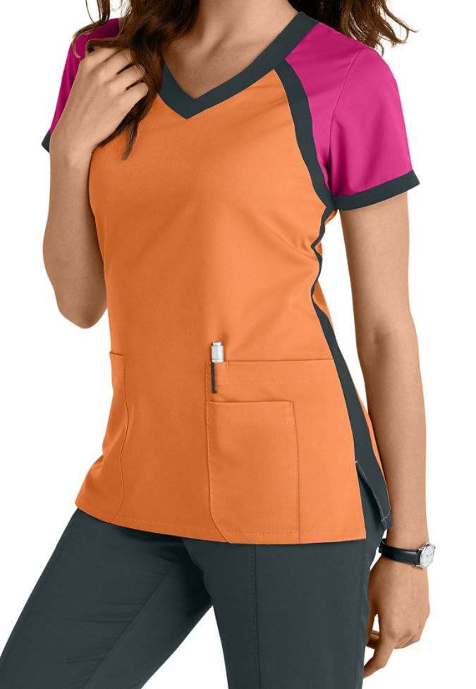 Grey's Anatomy 3 pocket color block v-neck scrub top in Citrus