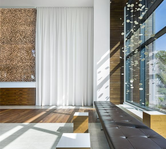 POINTE-NORD | Montreal | Architecture | Interior Design | Evolo 2 | Residential | Wood | Bench | Windows | Lobby | White | Gold | Art | Light | Ceramics | Artwork | Leather | Fabric