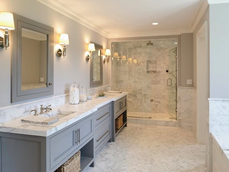 gray double vanity w/open shelves | marble shower, counters & herringbone floor