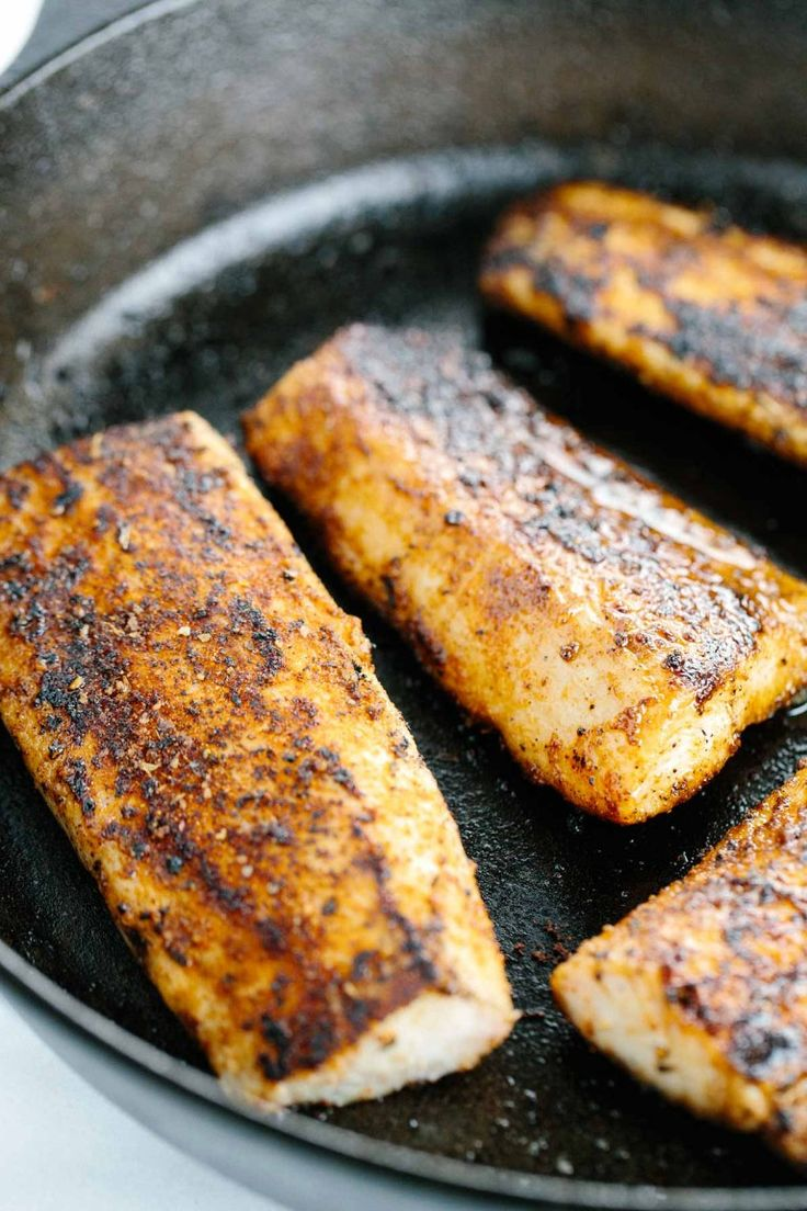 Searing mahi mahi fish fillets in a cast iron pan | jessicagavin.com