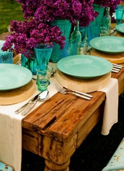 love the combo of glam and rustic maybe mason jars instead of the blue vases but like the purple flowers. burlap-esque runner.