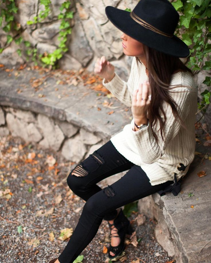 The long side-tie sweater and distressed black jeans are giving us life right now! Style them together for an edgy-yet-sweet look!