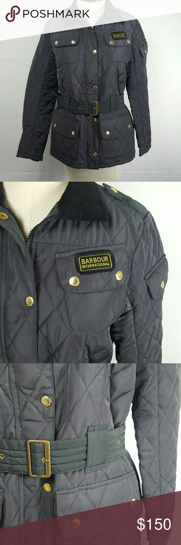 """BARBOUR INTERNATIONAL quilted waterproof jacket Top of the line quality and classic, military-inspired styling to boot!  Quilted waterproof polyester jacket with a belted waist and the option to turn up and belt the corduroy collar.  The color is a beautiful slate grey, but it does take on an almost olive tone in certain lighting.  Zippered front, with a button snap placket, 5 button snap pockets, gold hardware and zippered wrist panels.  InEUC.  UK size 10, US size 6.  21"""" armpit to armpit…"""