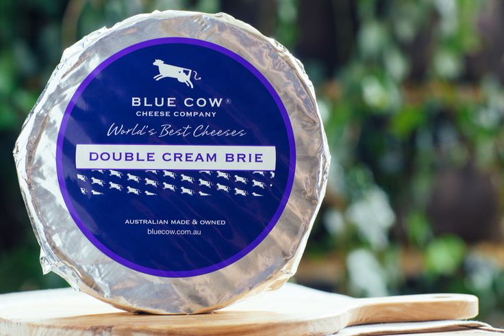 Blue Cow Double Cream Brie - Made in the traditional manner of classic French Brie this  cheese is matured for six to eight weeks. When ripe, the  paste will exhibit a smooth, luscious texture with a rich and creamy flavour.
