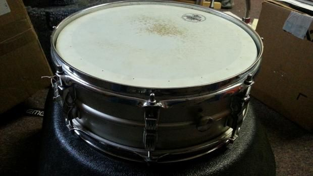 For sale is a used early 80s Ludwig Acrolite Snare drum with a blue and olive rounded serial badge.