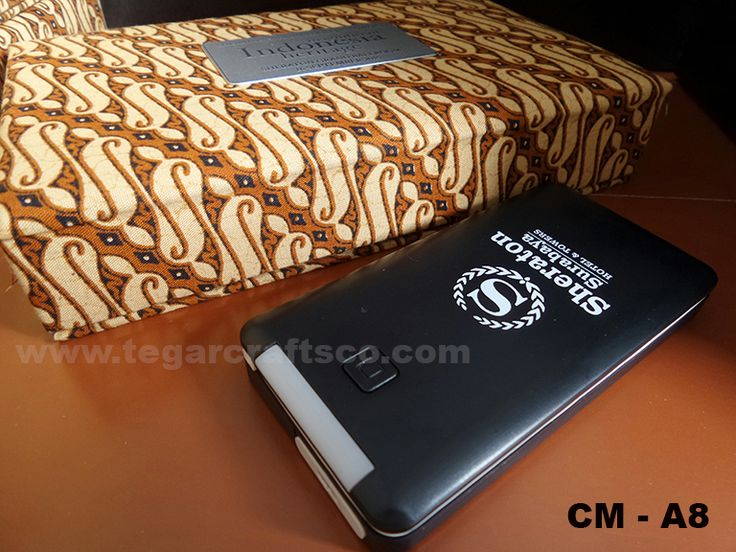 Each of our products has been equipped with a luxury black box, but if you wanted more for the design and shape it can to be tailored to your event, we can provide choice. A powerbank CM - A8, 5600 mAh with batik custom box ordered by Sheraton Hotel Surabaya. We made with batik patterns to show the cultural noble of Indonesia, including a metal plate to remind date, event and tagline.