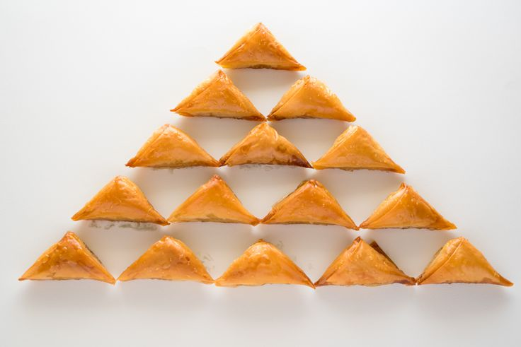 Sweet greek cheese pastry triangles drizzled with syrup Greek pastry project
