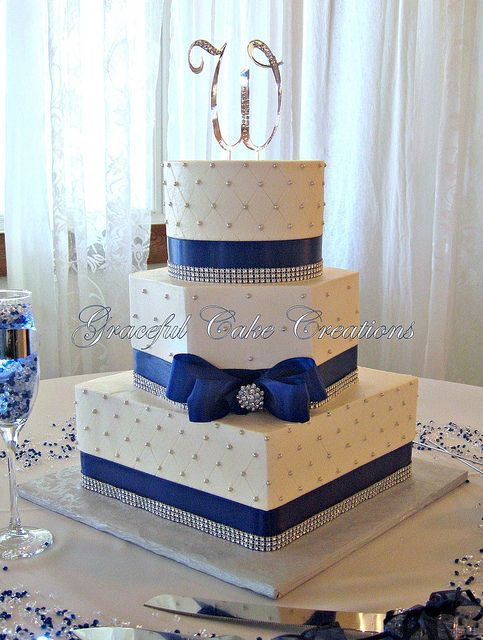 Elegant White Butter Cream Wedding Cake with Navy Blue and Bling Ribbon by Graceful Cake Creations, via Flickr.