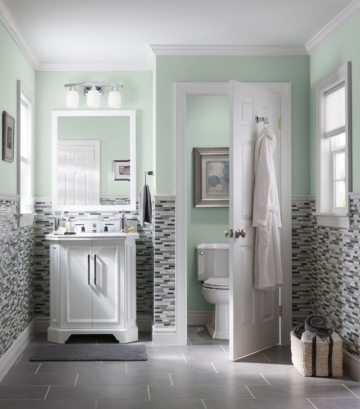 Delightful Design A Bathroom That Makes A Splash. Mosaic Wall Tile Complements Chic  Gray Floor Tiles Photo