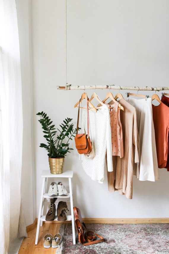 In your order please state: 1) Branch length (maximum 59 inches (150 cm)) 2) The length of the hanging system (vertical distance between the ceiling and the branch). For example: If you have 8 ft ceiling (2.43 meters) the perfect length for hanging system is 28.7 inches (73 cm). A new space to hang and display your favorite frocks, jackets, blouses, shirts and accessories. First. we found this amazingly shaped branch lying in our country home. We took it all the way back to our apartment…