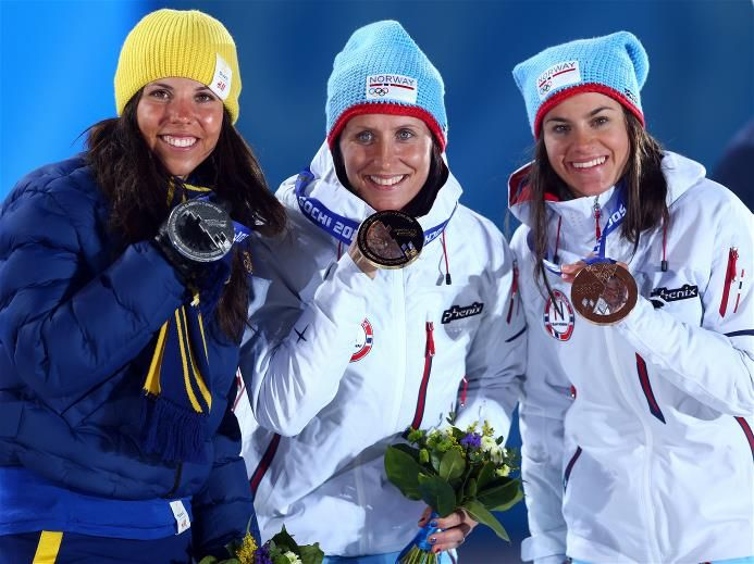 DAY 2:  (L-R) Silver medalist Charlotte Kalla of Sweden, gold medalist Marit Bjoergen of Norway and bronze medalist Heidi Weng of Norway on the podium during the medal ceremony for the for the for the Women's Skiathlon 7.5km Classic & 7.5km Free