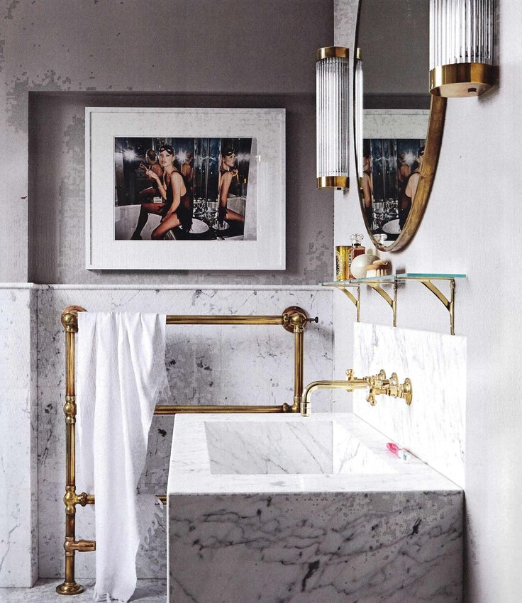 Marble bathroom, brass metalwork, Kate Moss artowrk, Living Etc.